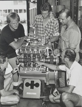 Students viewing the working of a car engine in the 1990s
