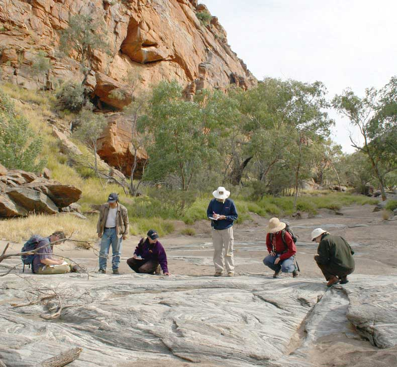 Geologists surveying a rock