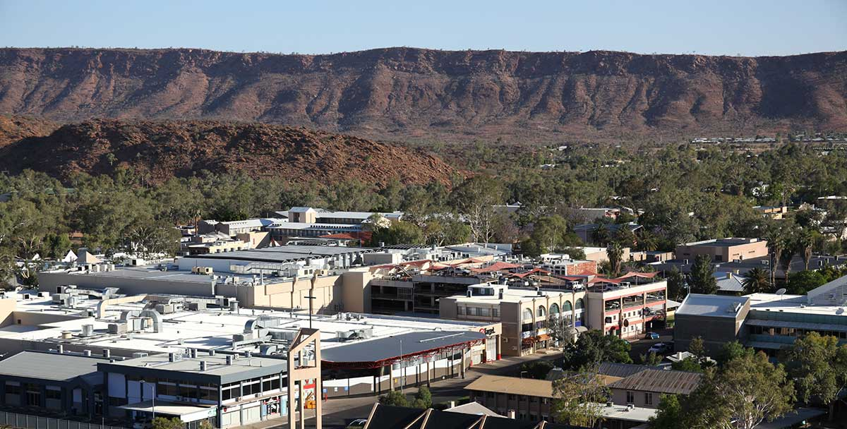 Aerial view of Alice Springs with the MacDonnell Ranges in background