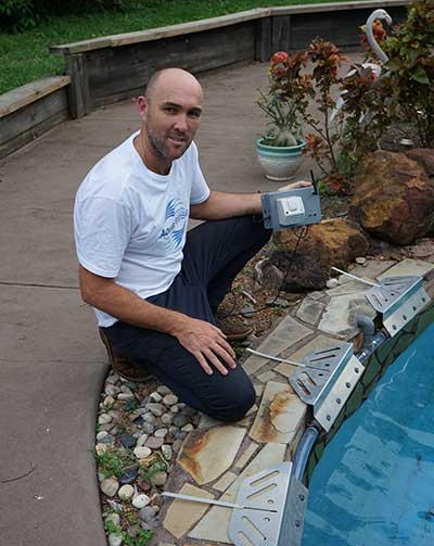 Michael Bruvel with his water cooling system for pools