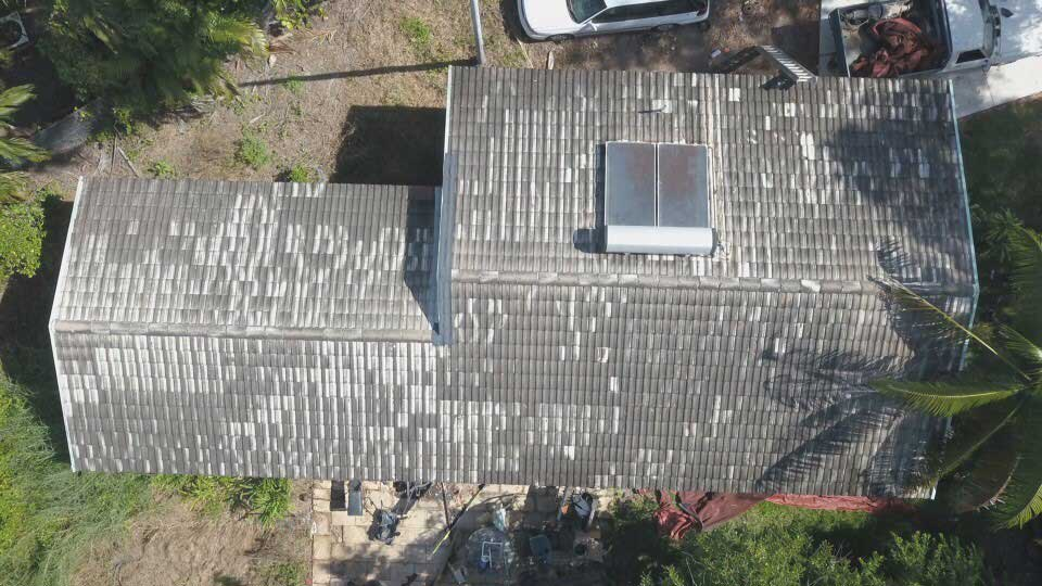 Shot of a damaged house roof before the repairs