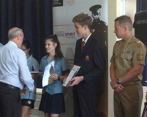 Students being presented their certificates