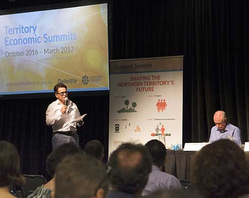 Luke Bowen talking to the audience and panel during the summit series