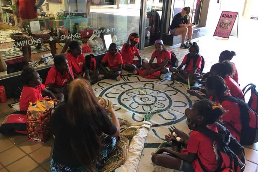 Tiwi students sitting in a circle at the Starwin stored in Darwin