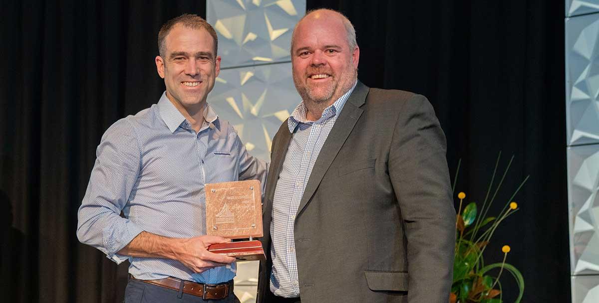 Trusty Glass Managing Director, Christopher Hatzimihail, receiving the Alice Springs Customer Service Award