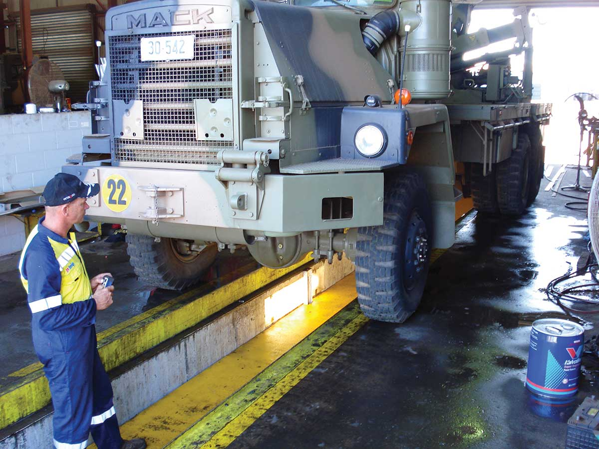 Workman working on a defence truck