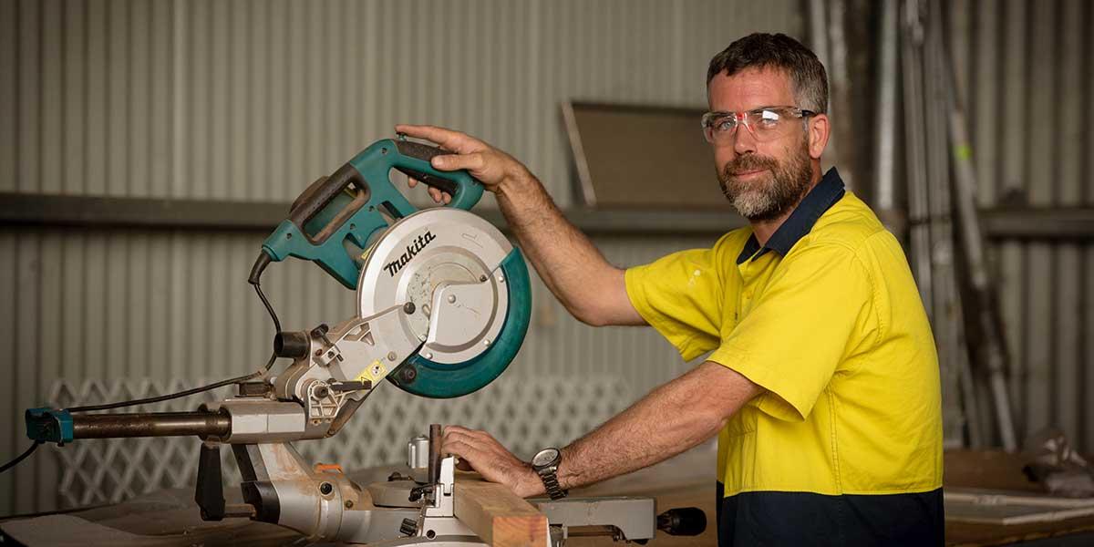Tradesman working with a drop-saw