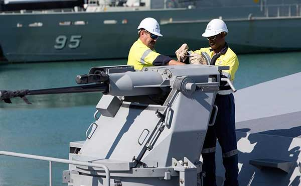Two men working on a Defence ship