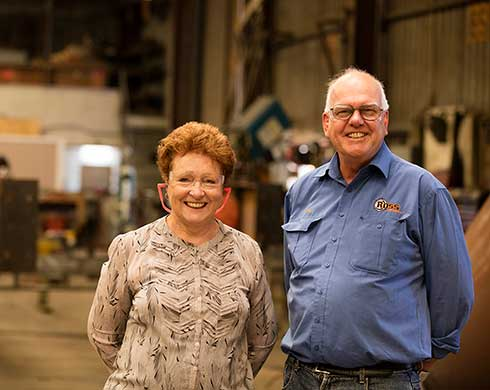 Man and woman standing in workshop